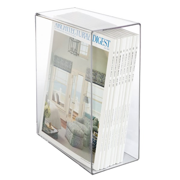 Magazines have a way of taking over the coffee table. Create an organized and eye-catching display on your bookshelf by dividing magazines by publication in a clear slipcase ($17 each).