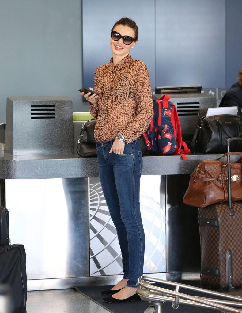 Miranda Kerr wore a see-through blouse and skinny jeans.