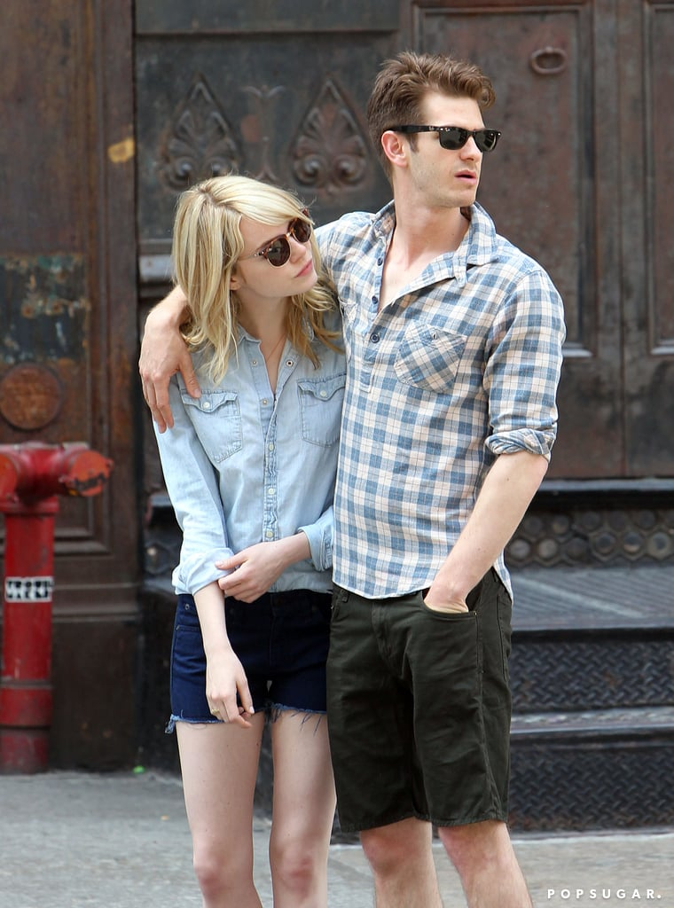 Andrew Garfield put his arm around Emma Stone.
