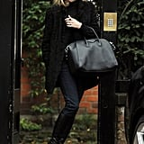 Kate Moss wore a coat over her all-black ensemble.