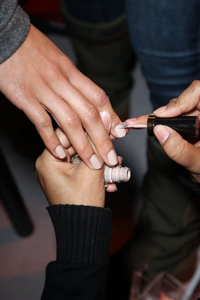 "Manicurist Jin Soon Choi applied two coats of Revlon polish in Elegant for a ""mannequin nail"" look. It's this greige tone that creates the illusion of longer nails."