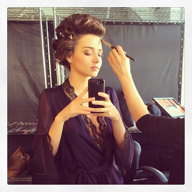 Miranda Kerr donned a revealing robe while snapping a selfie in the makeup chair. Source: Instagram user mirandakerr