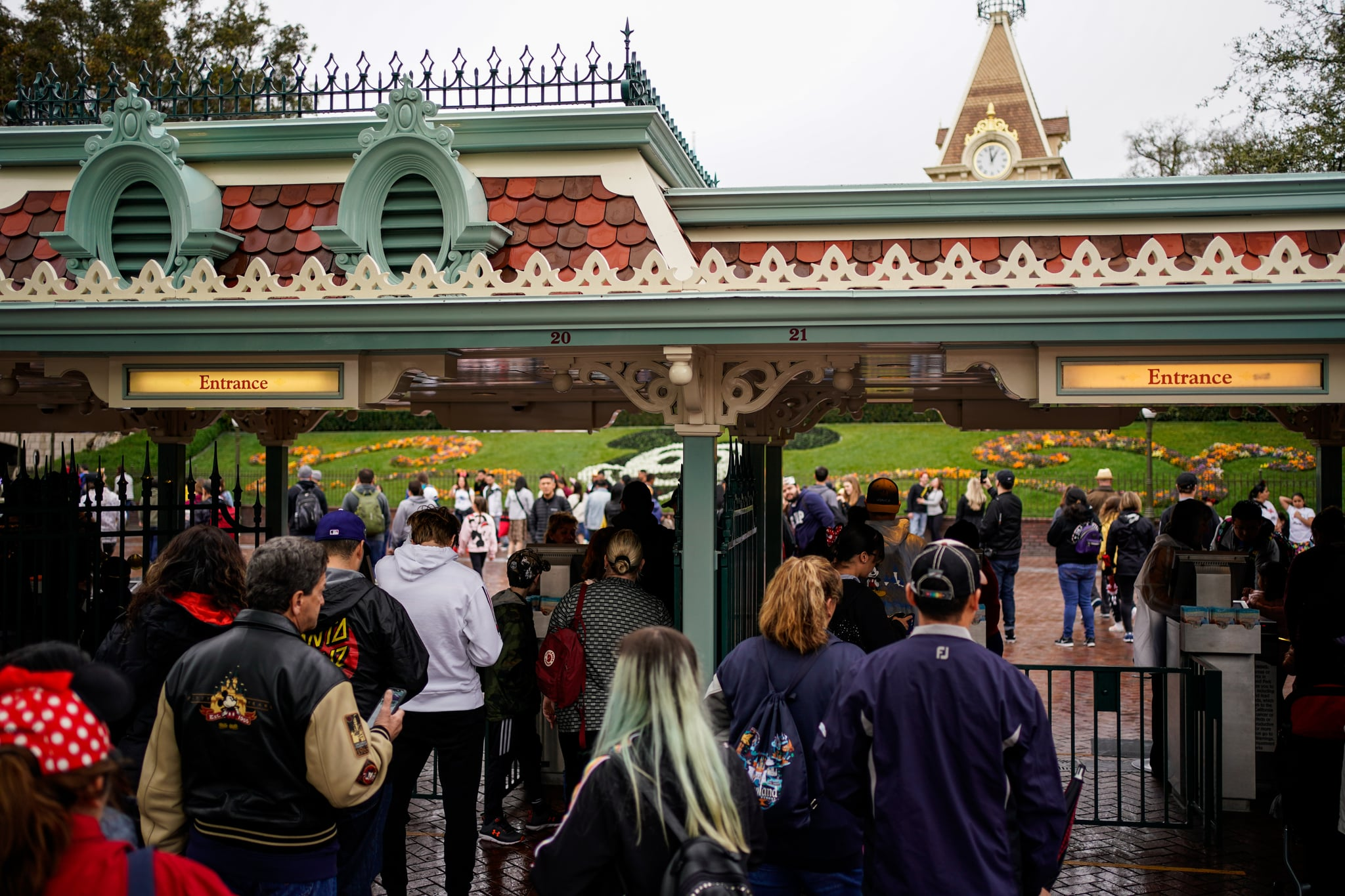 ANAHEIM, CA - MARCH 13: People wait in line to enter Disneyland on March 13, 2020 in Anaheim, California. Disney's two Southern California Theme Parks, California Adventure and Disneyland are shutting down temporarily until the end of March as a result of the spread of the Coronavirus. (Photo by Kent Nishimura/Los Angeles Times via Getty Images)