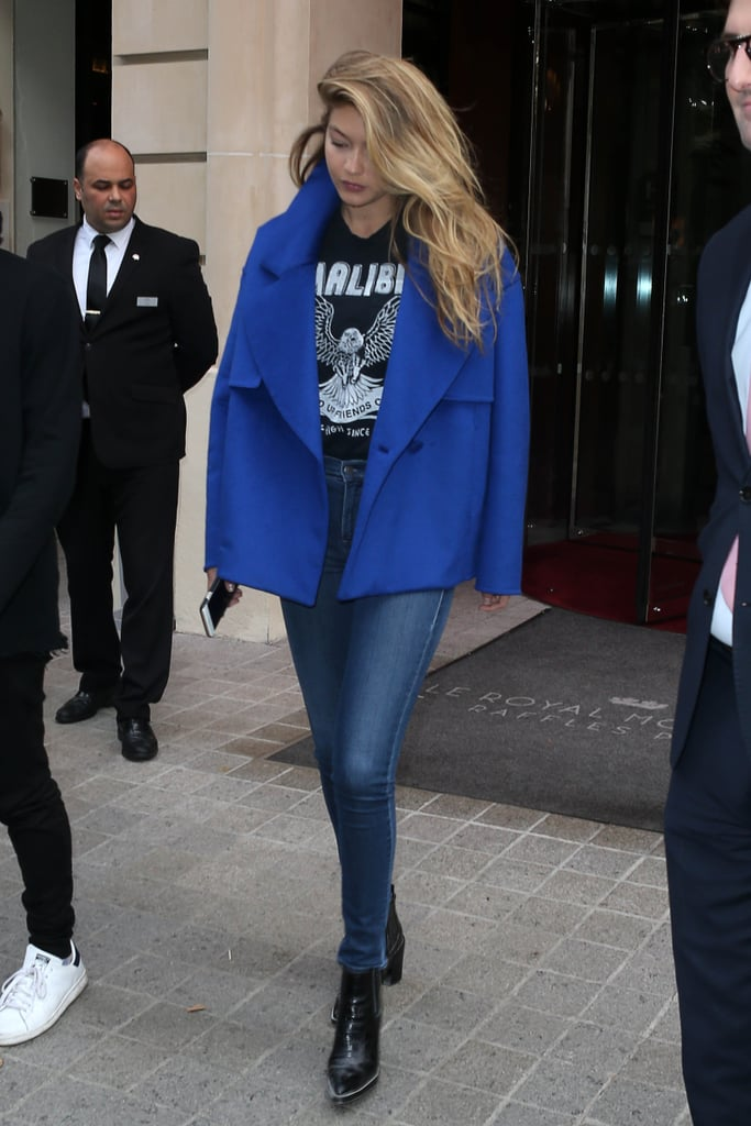 Wearing Parker Smith skinny jeans with black booties, a graphic tee, and a blue coat.