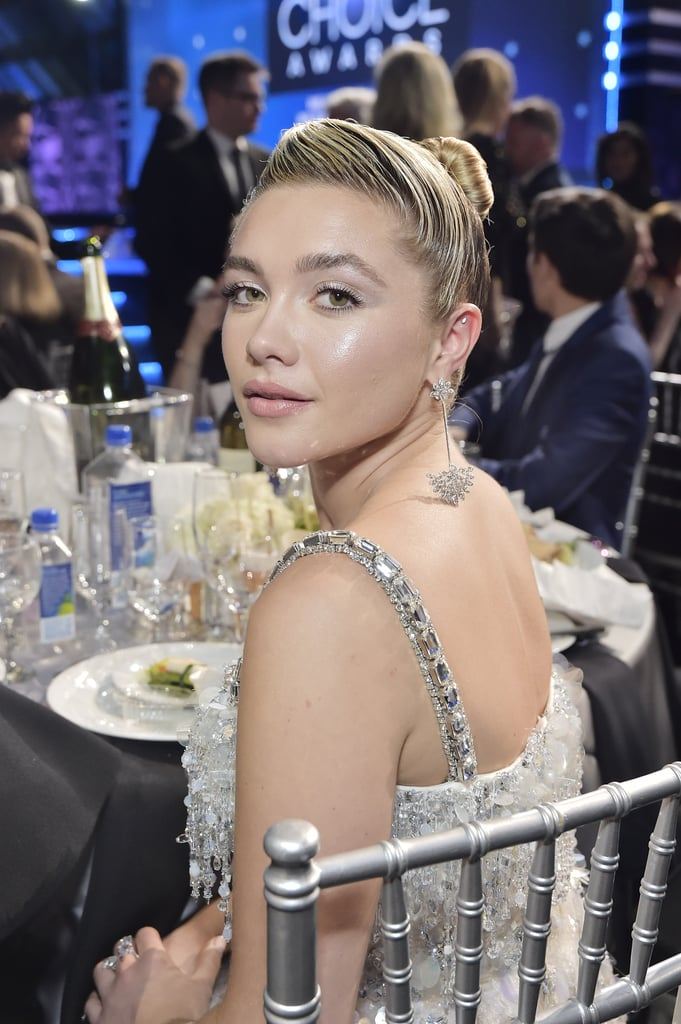 Florence Pugh was dripping glamour at the Critics' Choice Awards on Sunday night. The 24-year-old actress attended the Los Angeles ceremony rocking a silver iridescent gown with drop earrings and an updo. She was there in support of her films Midsommar, which earned a nomination for best sci-fi or horror movie, and Little Women, which earned eight nominations, including best picture and best acting ensemble. Florence also received a nod in the best supporting actress for her portrayal of Little Women character Amy March. Look ahead to see more photos from her night!      Related:                                                                                                           Presenting the 2020 Critics' Choice Awards Winners: Regina King, Jharrel Jerome, and More!