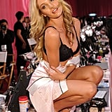 6. Candice Swanepoel struck a sultry pose backstage.