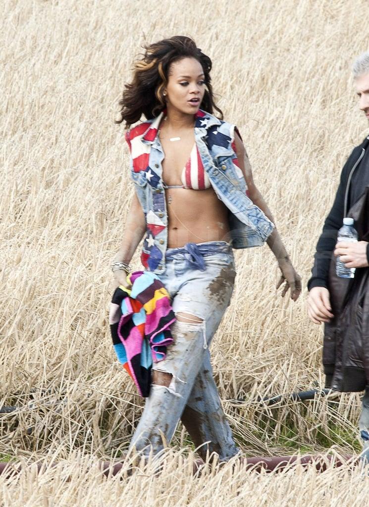 Rihanna in a bikini top and loose jeans.