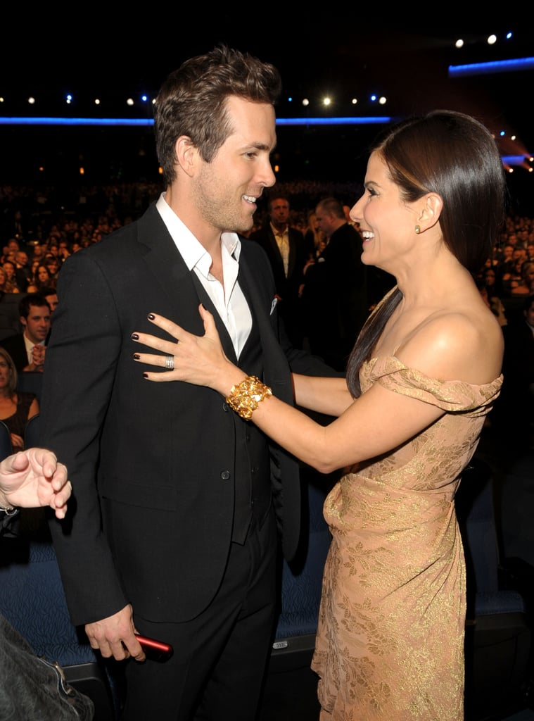 Long-time friends Ryan Reynolds and Sandra Bullock shared a laugh together in 2010.