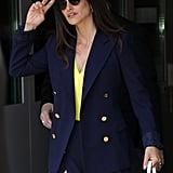 Wear your neon one-piece under sophisticated workwear for a bold twist like Penelope Cruz.