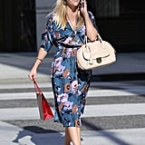 Reese highlights every shade of her floral prints with coordinated earrings and necklaces and orange-tinged sunglasses.