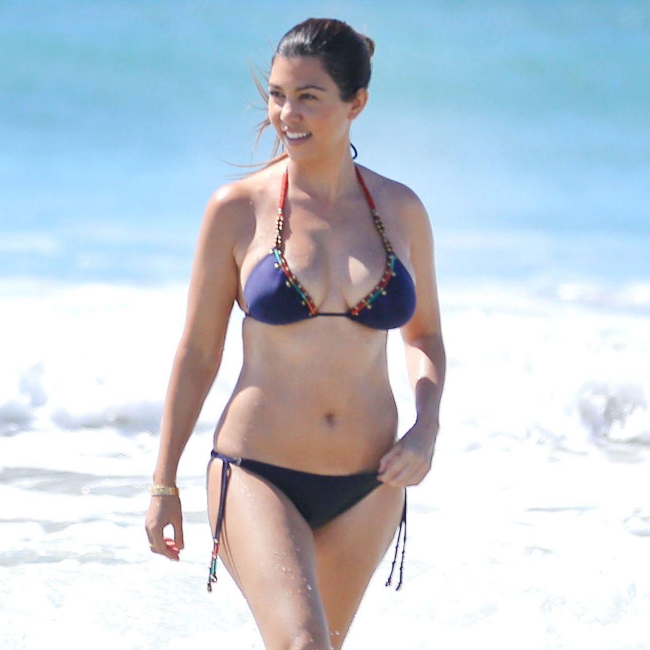 With her voluptuous body and Black hairtype without bra (cup size 34D) on the beach in bikini