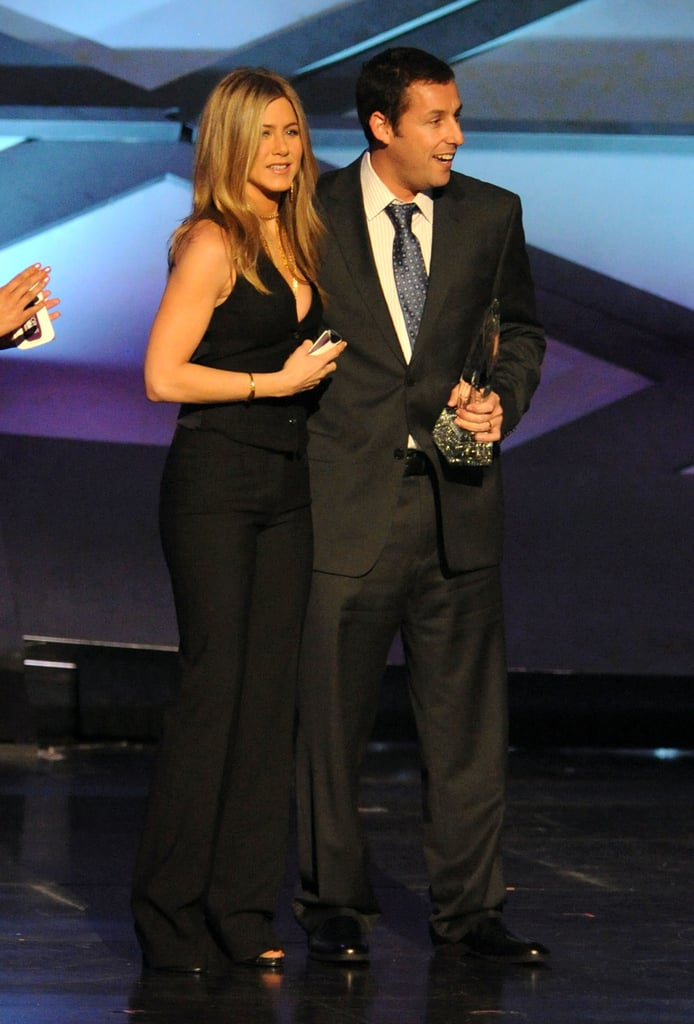 Jennifer Aniston handed out the first statue of the show at the People's Choice Awards. She stepped out in a sexy black vest and pants to present favourite male movie comedy actor, which fittingly went to her Just Go With It costar Adam Sandler. The two bantered a bit about their upcoming film while on stage, and he also helped take home favourite comedy movie for Grown Ups. Weigh in on all the night's fashion with Fab and Bella's live love it or leave it polls!