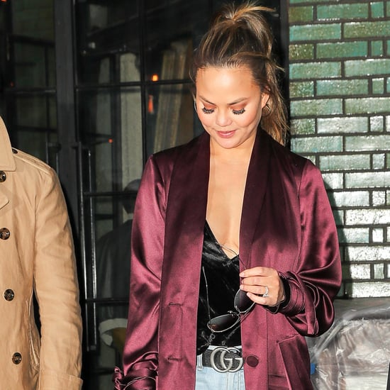 Chrissy Teigen Wearing Purple Satin Duster Coat and Jeans