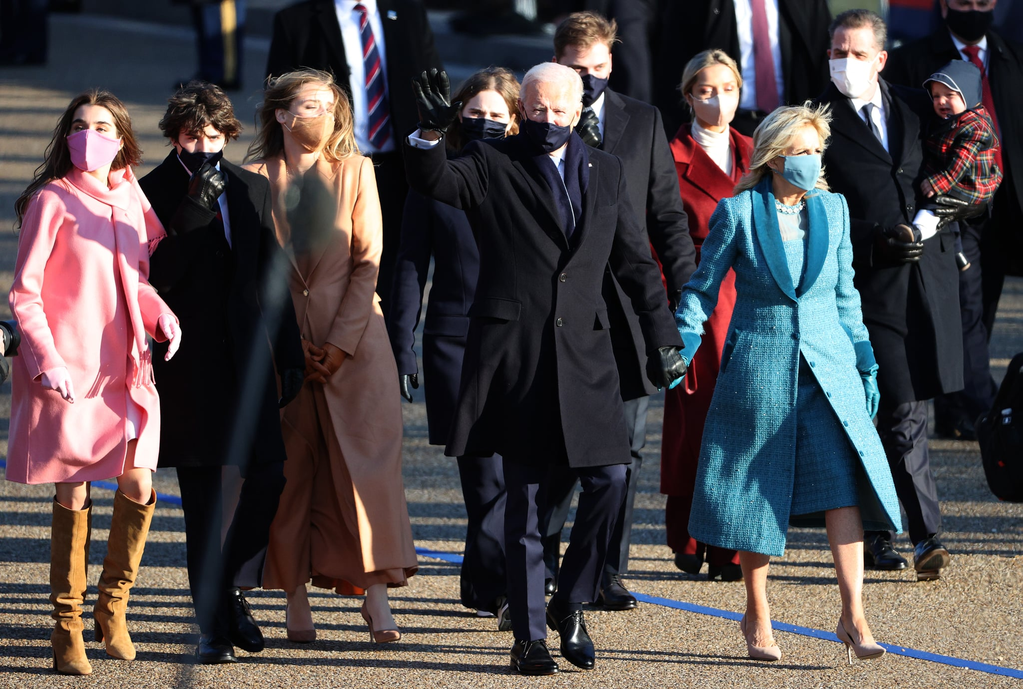 WASHINGTON, DC - JANUARY 20:  U.S. President Joe Biden and First Lady Dr. Jill Biden and family walk the abbreviated parade route after Biden's inauguration on January 20, 2021 in Washington, DC.  Biden became the 46th president of the United States earlier today during the ceremony at the U.S. Capitol.  (Photo by Patrick Smith/Getty Images)