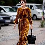 With a Velvet Dress, Circular Bag, and Cat-Eye Sunglasses