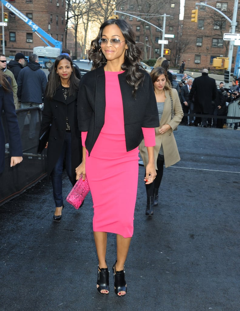 Zoe Saldana was a breath of fresh air in a punchy pink top, a tube skirt, and black open-toe booties, all by Michael Kors, with a structured black jacket and gradient aviators on her way to Lincoln Center during NYFW.