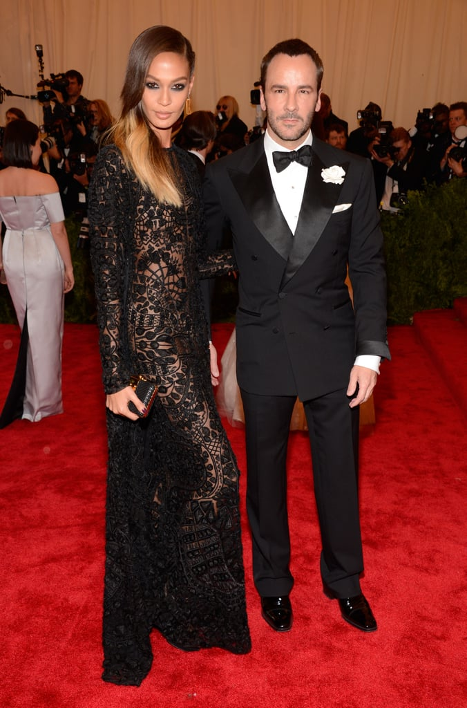 Joan Smalls showed off her sexy black sheer Tom Ford gown alongside the tuxedo-clad designer.