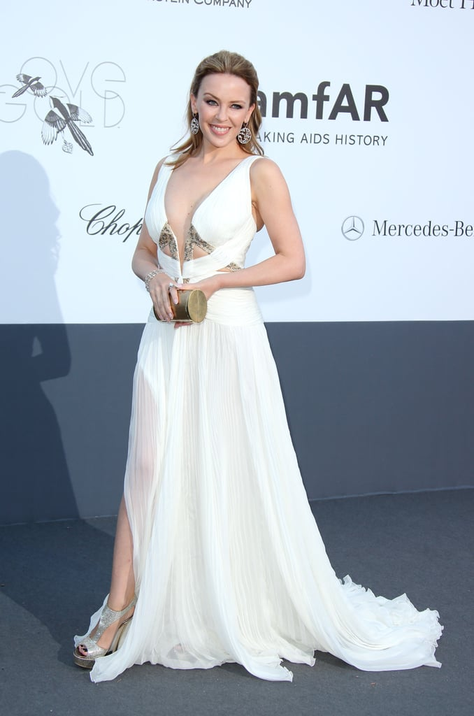 Kylie Minogue took the plunge in a white embellished Robert Cavalli gown and equally snazzy add-ons at amfAR's Cinema Against AIDS gala.