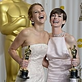 Jennifer Lawrence and Anne Hathaway celebrated their big wins in the press room.