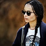Zoë Kravitz as Bonnie Carlson in tortoise sunglasses and a graphic t-shirt.