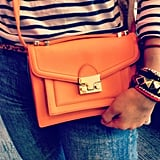 Nothing will brighten up a day — or outfit — more than a bright orange mini Loeffler Randall bag.