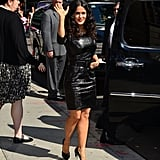 Salma then changed into an entirely different number, something way more sexy and serious: a black leather dress and black Casadei pumps with Plexi heels.