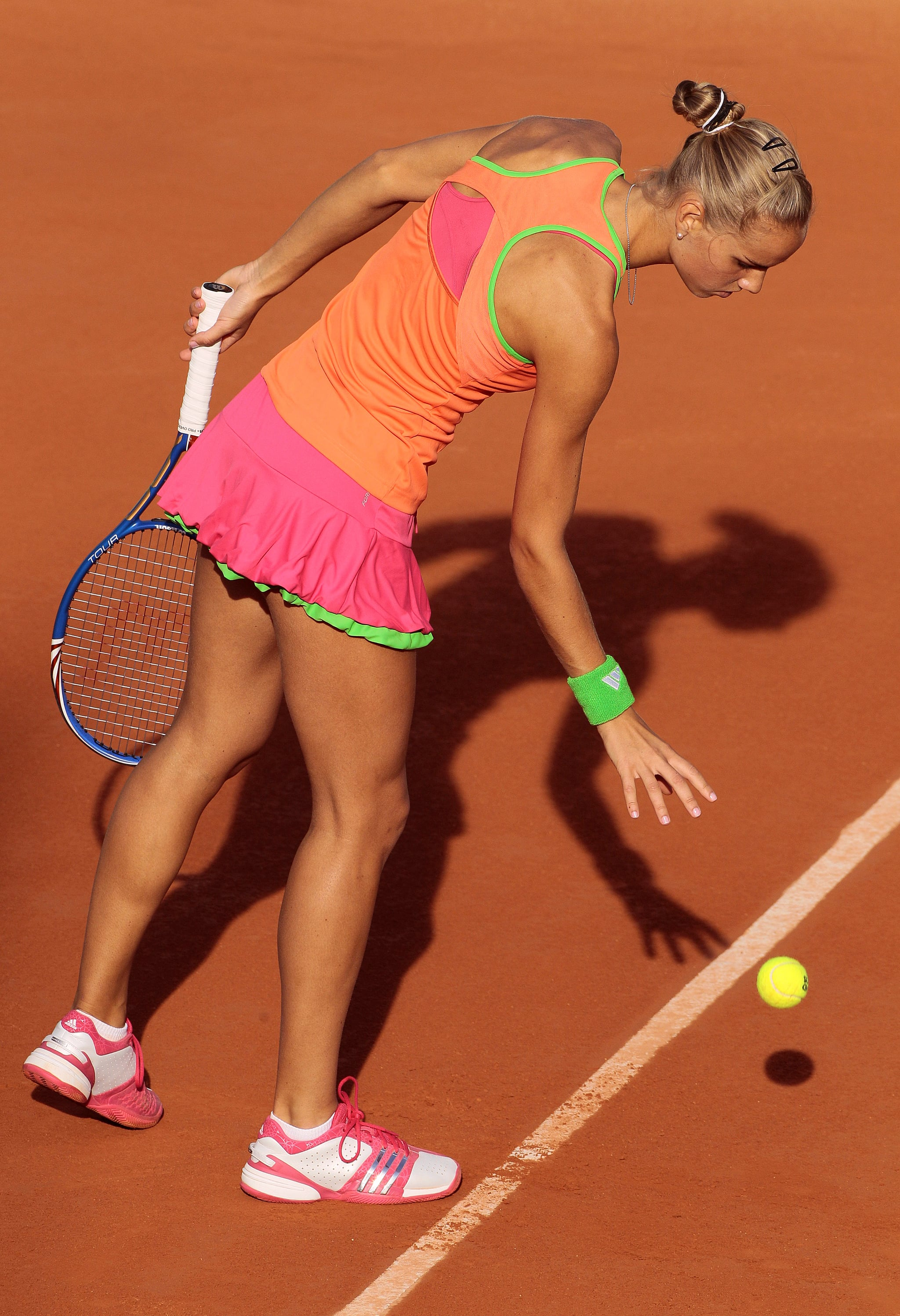Arantxa Rus donned bright colours at the French Open tennis championship at the Roland Garros stadium in May 2011.