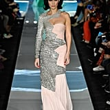 Wearing an asymmetrical dress at Moschino.