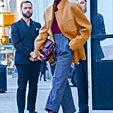 Victoria owns another pair of burgundy heels, which she wasn't afraid to pair with her camel coat.