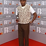 At the 2020 Brit Awards, Tyler posed with his award wearing a funky animal-print sweater vest, a Golf Wang hat, and Converse.