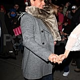 Tom Cruise carried Suri to dinner in NYC.