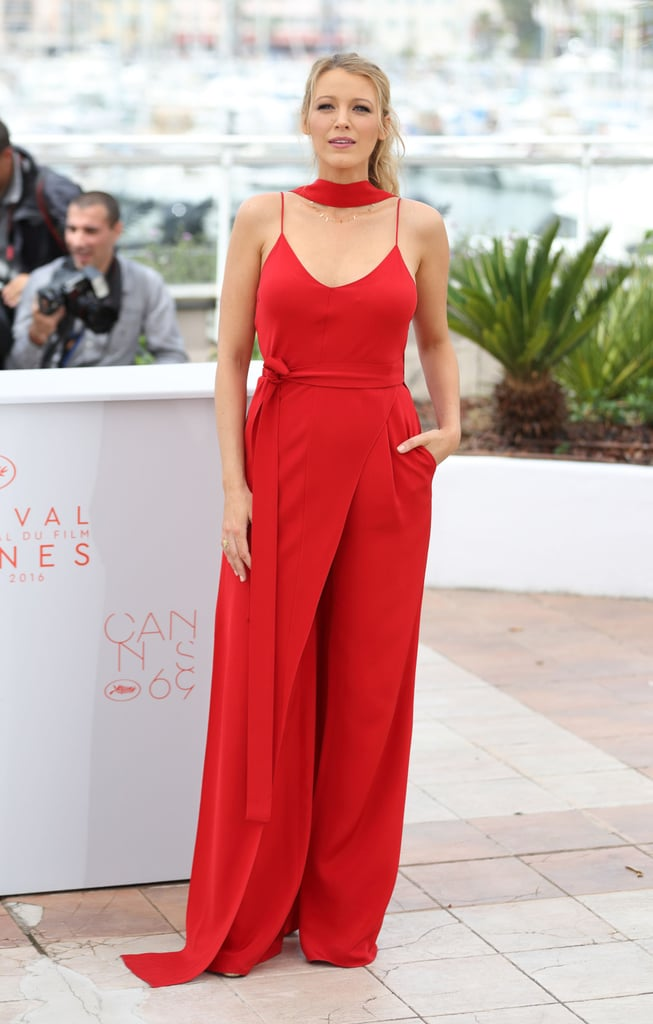 For her first photo call, Blake Lively selected a bright red Juan Carlos Obando jumpsuit.