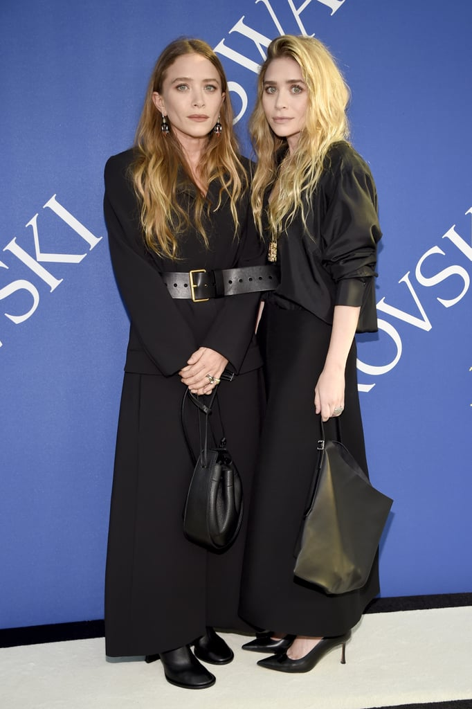 Mary-Kate and Ashley Olsen stepped out in style for the annual CFDA Awards in NYC on Monday night. The 31-year-old sisters coordinated their outfits, as per usual, and hit the red carpet together upon their arrival. The star-studded event also brought out Irina Shayk, Traceee Ellis Ross, Karlie Kloss, and Rosie Huntington-Whiteley, and will be honoring Kim Kardashian with the first-ever fashion influencer award.  Even though Mary-Kate and Ashley usually keep a profile, they've already blessed us with not one but two other fun appearances this year. In April, the sisters had a girls' night at the Youth America Grand Prix gala, and the following month, they attended the Met Gala. We just love seeing these two together!