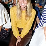 Dree Hemingway styled up a gorgeous Fall look, in a yellow knit and contrasting leather pants, front row at Ermanno Scervino.