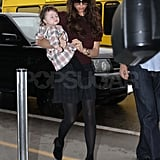 Victoria Beckham carrying Harper at LAX.