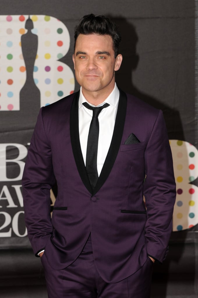Robbie Williams wore a purple suit for the Brit Awards in London.