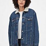 For a more subtle way to add the fabric into your wardrobe, try this Sherpa-Lined Oversized Icon Denim Jacket ($98). The lined collar will act as an extra cold barrier, without compromising the overall vibe that denim exudes.