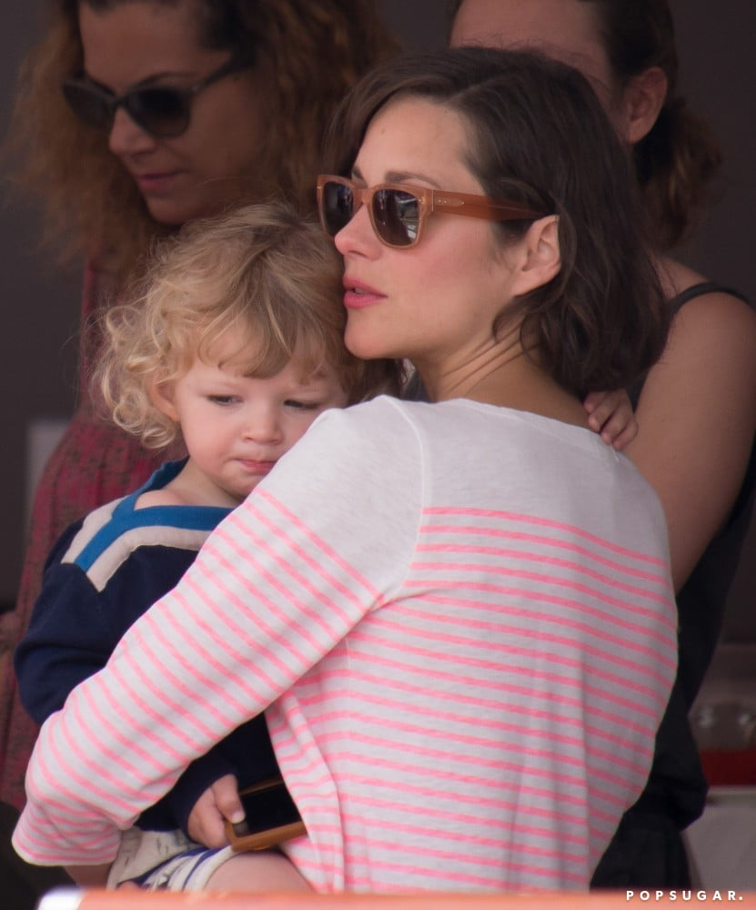 Marion Cotillard held her son, Marcel, close at the Monaco Jumping Show.