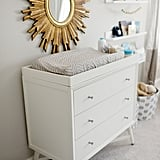 """The wallpaper I created for Samuel is my favorite part of the nursery. Before he was born, I pictured him in his room and knowing I made something special for him put a smile on my face,"" Catherine said. Mid-Century 3 Drawer French White Dresser ($729, originally $949) Sunburst Round Mirror ($346) Picture Ledge Floating Wall Shelf ($21, originally $45)"