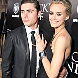 Zac Efron held onto Taylor Schilling at The Lucky One premiere in LA.
