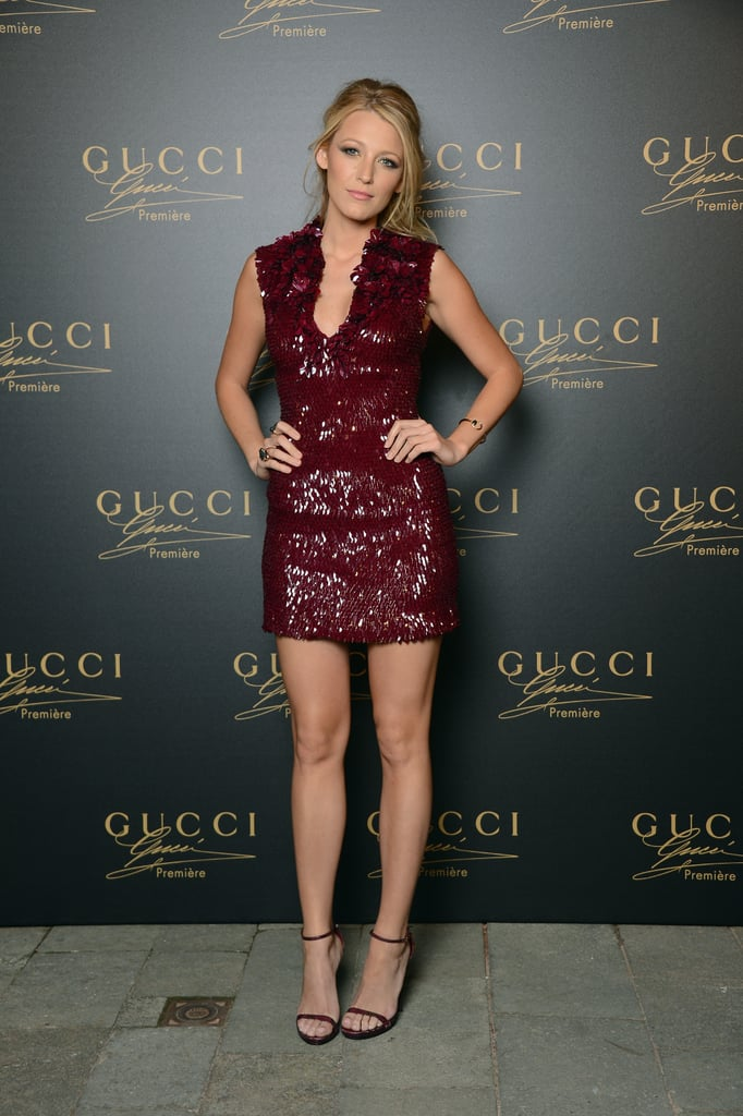 Blake Lively, the face of the Gucci Premiere fragrance, stepped out for the brand's launch party in an embellished burgundy Gucci Premiere cocktail dress. She paired it with simple Gucci sandals and a Gucci bracelet.