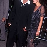 Wearing a beaded midi dress at the Donnie Brasco premiere with Johnny Depp in 1997.