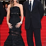 Kate Beckinsale (in Nina Ricci) and Benicio Del Toro stand like attractive statues.