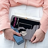 A novel clutch? We're obsessed with the booky-chic effect.