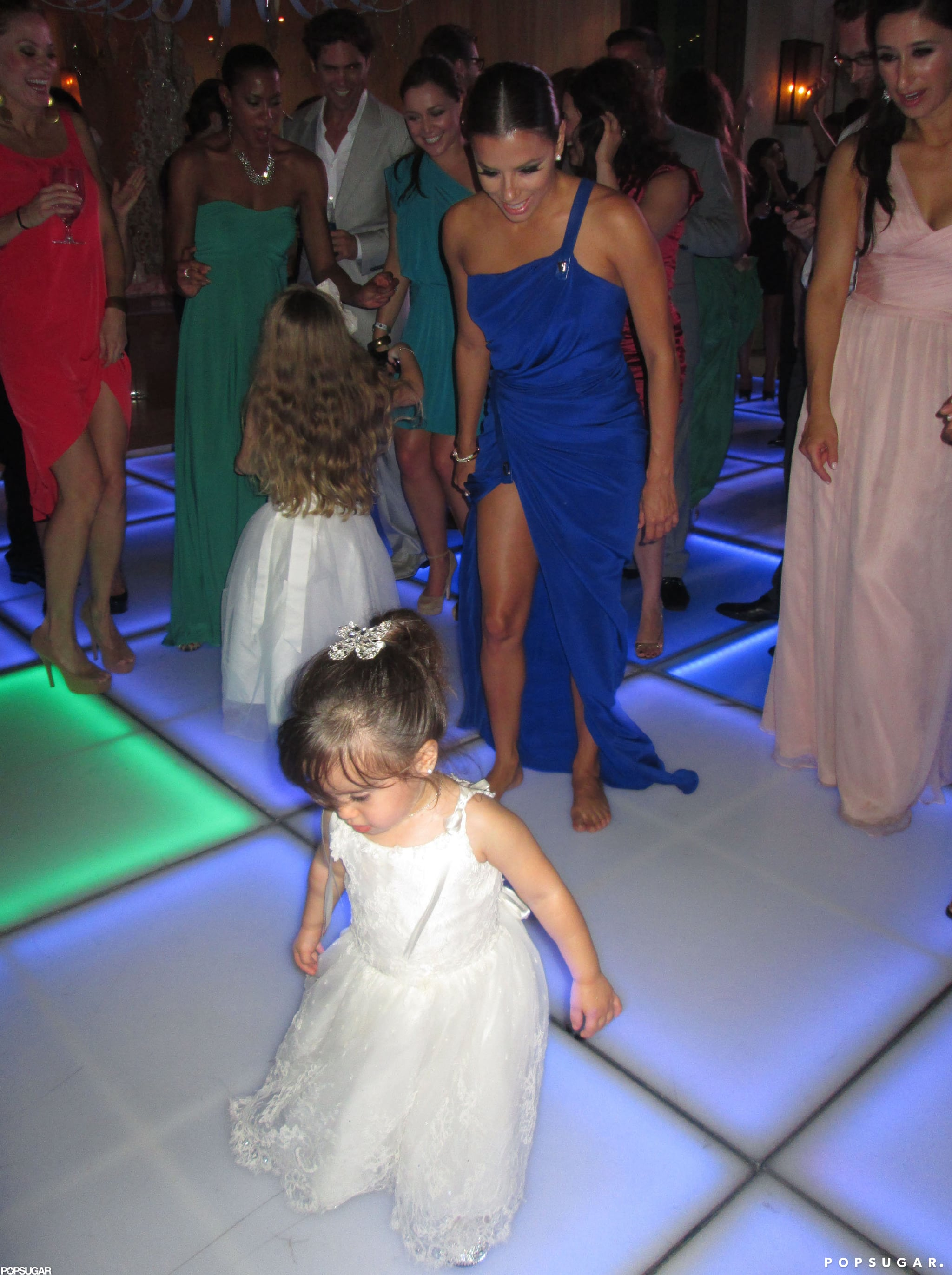 Eva Longoria danced with the flower girls at Mario Lopez and Courtney Mazza's ceremony in Punta Mita, Mexico, in December 2012.