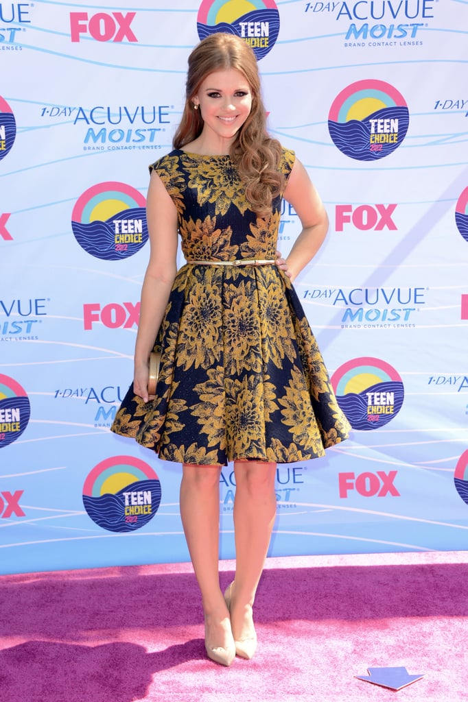 Holland Roden donned a printed fit-and-flare Alice + Olivia dress, Lauren Merkin clutch, Neil Lane earrings, and nude Christian Louboutin pumps.