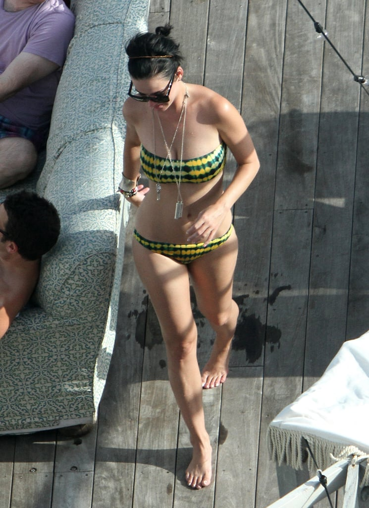 In July 2012, Katy Perry looked great in her printed bikini while spending time with friends in Miami.
