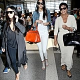 Kim Kardashian and Kendall and Kris Jenner caught a flight at LAX on Thursday.