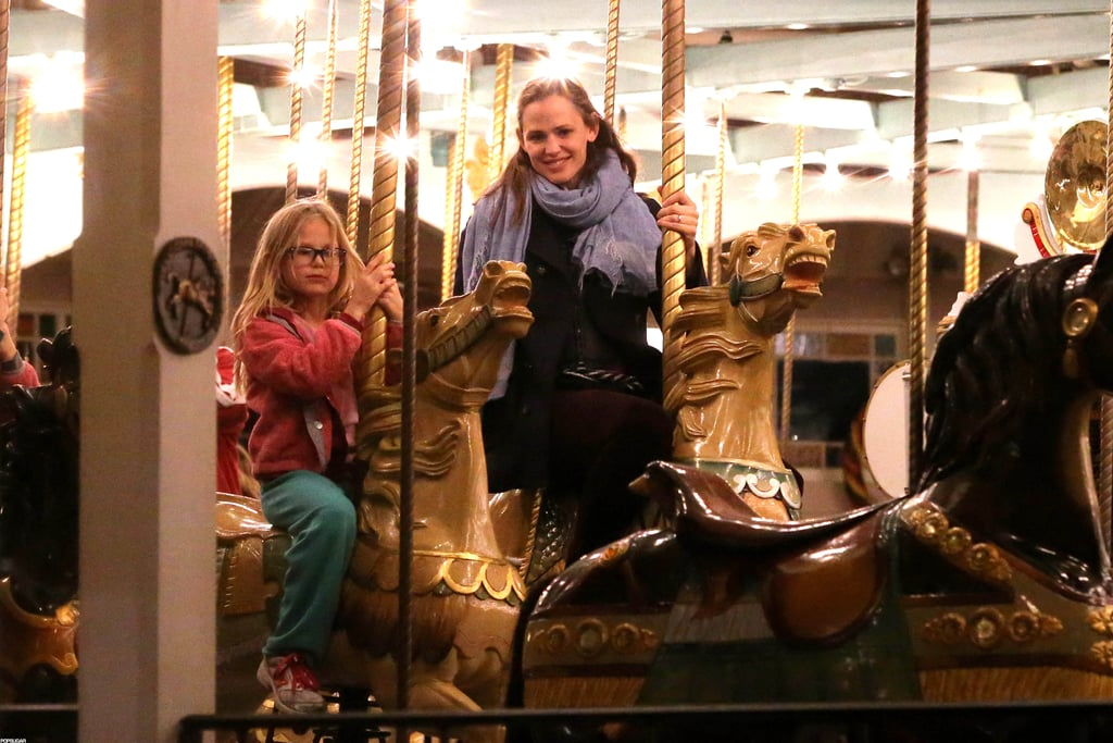"Jennifer Garner had a fun-filled evening with Violet and Seraphina Affleck at the Celebration in the Oaks fair in New Orleans yesterday. The mom of three got in on the action by climbing aboard a merry-go-round horse and snapping pictures of the girls. The mother-daughter trio also took the bumper cars for a wild ride around the track, then cuddled up close for a spin on the Ferris wheel.  The family night out came between filming days for Jen, who began working on The Dallas Buyer's Club with Matthew McConaughey and Jared Leto earlier this month. Jen had Sera and Samuel on set with her last week, while Ben Affleck trekked to Washington DC for an appearance on This Week With George Stephanopoulos. Ben spoke about the crisis in the Congo and the efforts his organization, Eastern Congo Initiative, is taking to help remedy the violent conflicts. Aside from his career as a writer, director, and actor, his passion for international affairs may have been what helped him land a spot on Barbara Walters's annual ""Most Fascinating"" list."