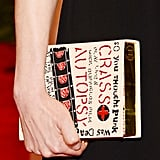 Michelle Williams carried an Olympia Le-Tan book clutch.